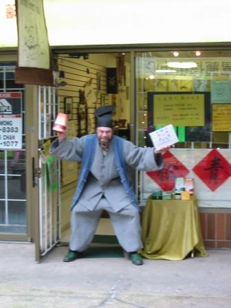 And From No-Where A Polish Freak Dressed Like a Korean Selling Tea to The Chinese!