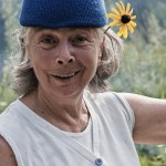 Blue Toque and wild flower